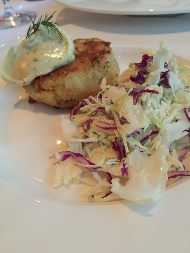 Dungeness crab cake with coleslaw.