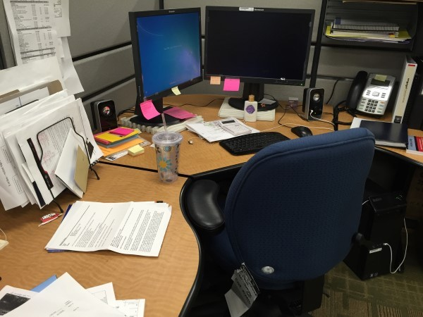 Messy, disorganized, not-so-pretty desk.