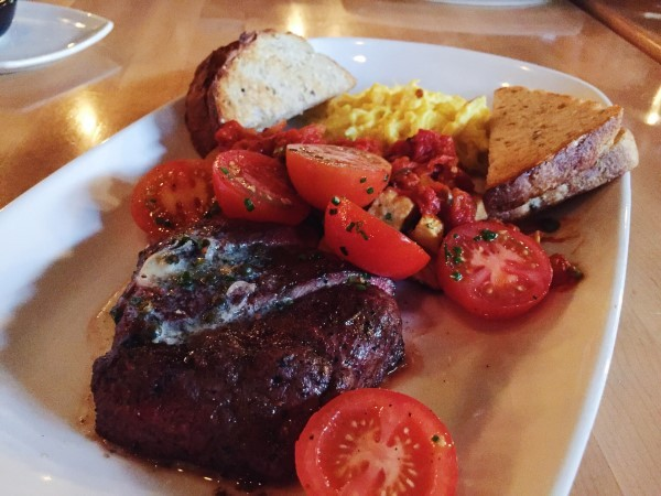 'Steak and eggs' consists of a flatiron steak, free-run eggs heirloom tomato salad, and our beloved patatas bravas.