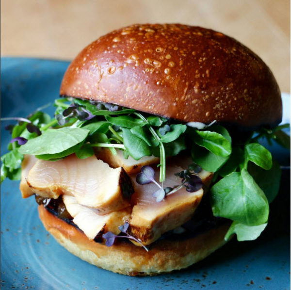 Grilled albacore tuna burger, ginger glaze, jalapeño & apple chutney, yuzu aioli, peppery greens.
