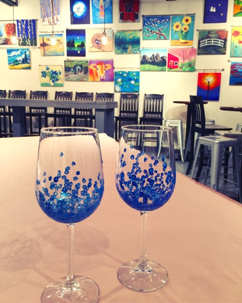 Painted wine glasses on table.