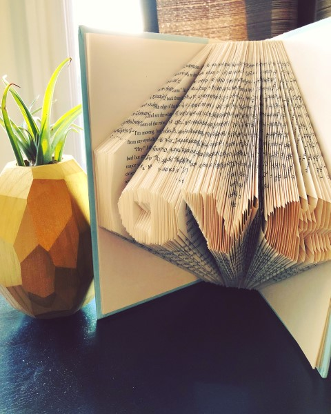 Book folding art for the word 'love'